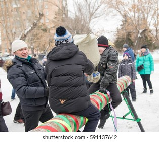 PETROPAVLOVSK, KAZAKHSTAN - MARCH 26, 2017: Shrovetide - folk festivals.  Unidentified children participate in comic battles with pillows. Kazakhstan.