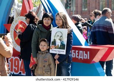 "PETROPAVLOVSK MAY 9, 2016: residents in memorable procession ""An immortal regiment"", on May 9, 2016. Kazakhstan Petropavlovsk."