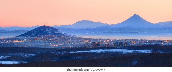 Petropavlovsk-Kamchatskiy at night the city skyline panorama against the volcanoes
