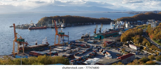 PETROPAVLOVSK-KAMCHATSKY, KAMCHATKA PENINSULA, RUSSIA - OCT 3, 2017: Panorama on ships at pier, port cranes on commercial seaport Petropavlovsk-Kamchatsky City on shore of Avacha Bay in Pacific Ocean.