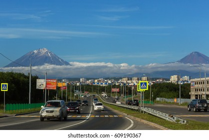Petropavlovsk-Kamchatsky, Russia - August 13, 2016: Petropavlovsk-Kamchatsky city on the background of Koryaksky and Avachinsky volcanoes