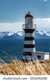 Petropavlovsky Lighthouse (founded in 1850) - oldest lighthouse on Kamchatka Peninsula in Russian Far East, on shore of Avacha Gulf in Pacific Ocean, in vicinity of Petropavlovsk-Kamchatsky City.