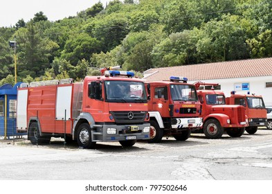 Petrovac, Montenegro, August 3 2015. Fire trucks in order from modern car to vintage one in the parking lot.