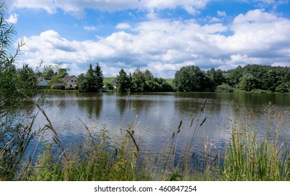 Petrovicky ponds and houses, landscape with reflections
