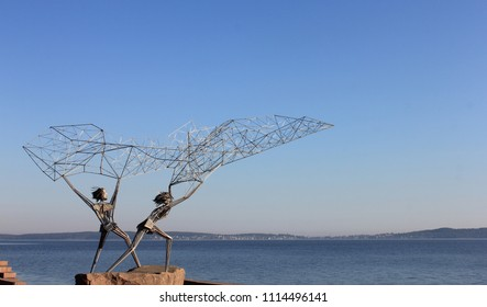 PETROZAVODSK, REPUBLIC OF KARELIA / RUSSIA - AUGUST 10 2014:  Monument Fishermen is original sculpture, installed on the shore of the Petrozavodsk bay of Onega Lake
