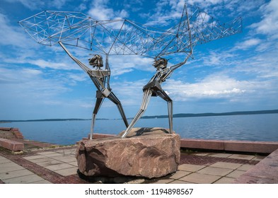 """Petrozavodsk, Republic of Karelia, Russia, August 05, 2013:  """"Fishermen"""" - sculpture on Onega embankment, gift from American twin-city Duluth"""
