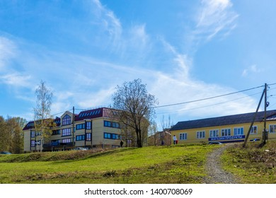 Petrozavodsk, Russia, 05.09.2019 Low-rise house and shop on a hill in a quiet city district