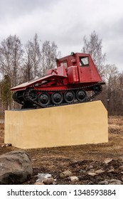 Petrozavodsk, Russia, 4.12.2014. the monument to the tractor - a real old Soviet tractor skidder at the Tractor Plant
