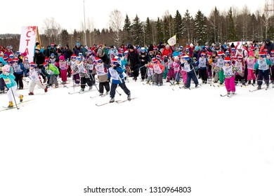 """PETROZAVODSK, RUSSIA - FEBRUARY 9TH, 2019: Winter mass sports holiday """"Ski Track of Russia"""". Kids starting their skiing competition"""