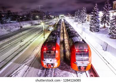 "Petrozavodsk, Russia - January 07, 2019: High-speed train ""Swallow"" night on the platform, Russian Railways"