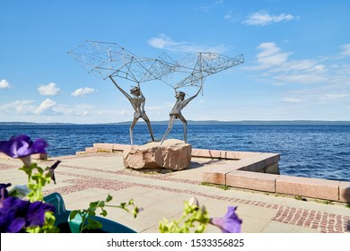 PETROZAVODSK, RUSSIA - JUNE 19, 2019: Sculpture on the embankment of the city of Petrozavodsk in Karelia in Russia on a Sunny summer day. Iron fishermen with a fishing net