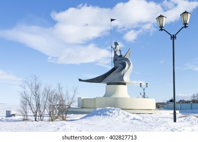 "PETROZAVODSK, RUSSIA - MARCH 19TH, 2016: View of winter quay of Lake Onega, Petrozavodsk, Russia. Sculpture ""Birth of Petrozavodsk"""