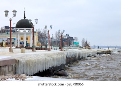PETROZAVODSK, RUSSIA - NOVEMBER 9TH, 2016: City embankment covered with ice after winter storm on the lake