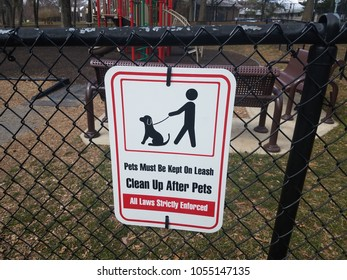 pets must be kept on leash sign at playground