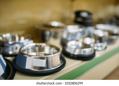 Petshop, shelf with water bowls for dogs and cats