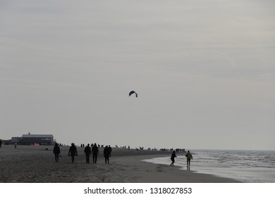 petten netherlands february 17 2019 people walking at the beach on a sunny winter day