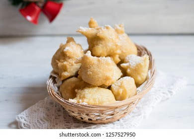 Pettole is a traditional christmas south italian food cooked from dough and fried in olive oil, made in Salento, Apulia