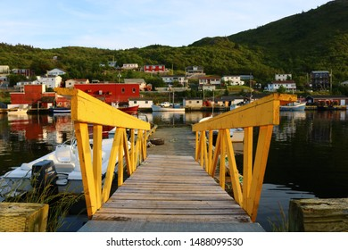 PETTY HARBOUR, NEWFOUNDLAND / CANADA - JULY 17 2019: Yellow Fenced Gangway to Floating Wharf in Petty Harbour!