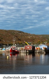 PETTY HARBOUR, NEWFOUNDLAND AND LABRADOR, CANADA - OCTOBER 18, 2015: Fishing boats and stages in the historic fishing village of Petty Harbour, taken on October 18, 2015, in Petty Harbour.