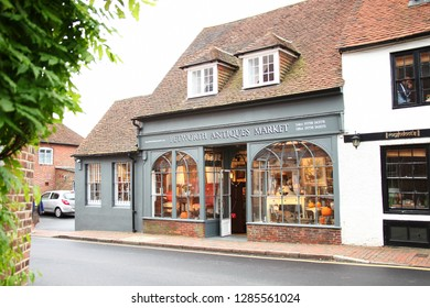 PETWORTH –OCT 23  : Local antique and collectible shop front decorated represent domestic retail business on October 23, 2015 in Petworth West Sussex, England.