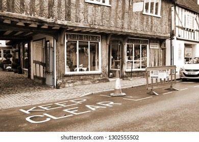PETWORTH –OCT 24  : Local antiques and decorative furniture shop front decorated represent domestic retail business on October 24, 2015 in Petworth West Sussex, England.