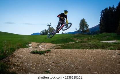 Petzen, Austria - October 16 2018: Mtb rider jumping the last jump at the dual slalom race line.