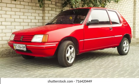 Peugeot 205. KHERSON, UKRAINE - SEPTEMBER 15, 2015: Old vintage hatchback Peugeot 205.The Peugeot 205 is a supermini car produced by the French manufacturer Peugeot from 1983 to 1998.