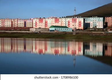Pevek city reflecting in the lake in Chukotka, Far East Russia