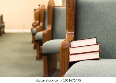 Pew with stacked books