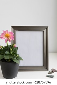 Pewter finish metal photo frame mock-up with dahlia