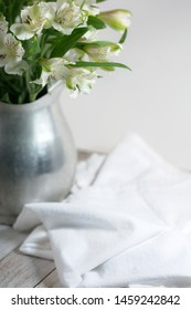 Pewter Pitcher with Flowers and Towel