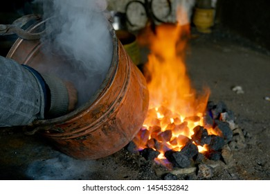 a pewter pots on fire