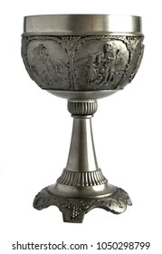 Pewter wine goblet with relief isolated on a white background