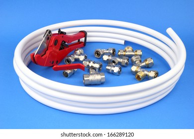 The pex pipe and armature on the blue background