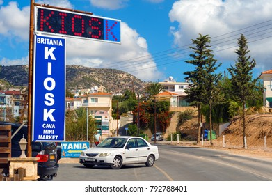 PEYIA, PAPHOS, CYPRUS - October 09, 2017: Car parkked on the street next to mini market. Peyia is the resort village near the Paphos city.