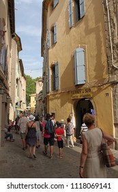 PEZENAS, FRANCE- july 21, 2016: Tourists people walking in the street of french touristic city of Pezenas, Herault in southern of France