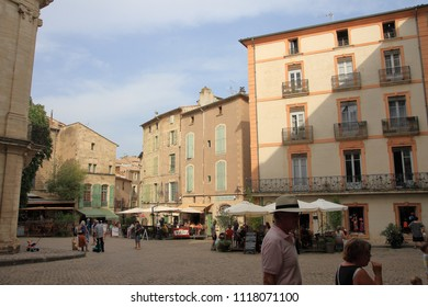 PEZENAS, FRANCE- JULY 21, 2016: Tourists strolling in the central square of the french city of Pezenas,  Herault in southern of France