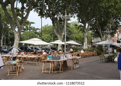 PEZENAS, FRANCE-JULY 21, 2016: Market Stand in the central square of the french city of Pezenas,  Herault in southern of France