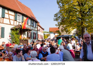 Pfalz/Germany- October 6 2018: Local wine street festival in a Palatinate wine village with timbered houses. Many attend it to taste fresh local produced wine at vintners and eat traditional food