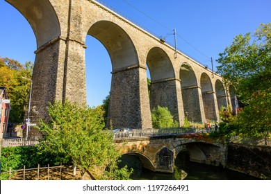 Pffaffenthal-Clausen, Luxembourg - October 4, 2018: The arched railway viaduct passes over the River Alzette near Rue du Fort Olisy