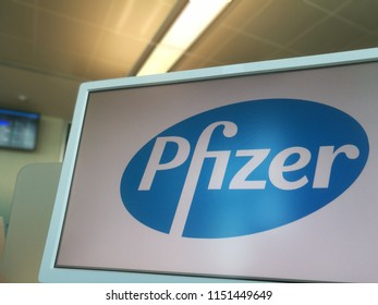 Pfizer Logo on a PC Monitor in a Coworking Place in Milan,Italy-July 2018
