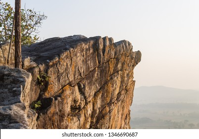 Pha Hua Rue Rock Cliff Phayao Attractions Thailand with Warm Sun Light and Tree Zoom Scene. Natural stone or rock mountain at Phayao northern Thailand travel