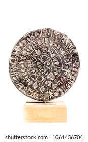 The Phaistos Disc is a disk of fired clay from the Minoan palace of Phaistos on the Greek island of Crete