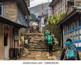 Phakding / Nepal - 10 09 2018: Porters in Phakding streets