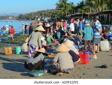 Phan Thiet, Vietnam - Mar 19, 2016. People sell seafood at the market in Mui Ne town, Phan Thiet, Vietnam. Mui Ne is a coastal fishing town in the Southern Vietnam.