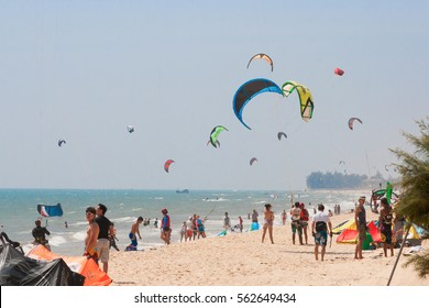 PHAN THIET, VIETNAM - NOVEMBER 19, 2011: People practicing kitesurf on the beach of Phan Thiet town (Mui Ne), Vietnam. Kitesurfing is a surface water sport