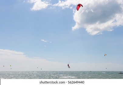 PHAN THIET, VIETNAM - NOVEMBER 21, 2011: Kitesurfer jumping on beautiful background. Kiteboarding is a surface water sport