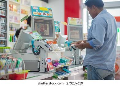 Phang Nga, 21 october 2014: 7-Eleven shop with cash desk at gas station in Phang Nga town, Phang Nga province, Thailand.