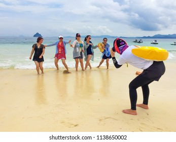 PHANG NGA, THAILAND - APRIL 26, 2017 : Chinese guide are taking photo for Chinese tourist in PP Isaland, Phang gna, Thailand.