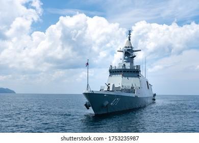PHANG NGA, THAILAND - APRIL 3, 2019 : HTMS Bhumibol Adulyadej (FFG471) stealth frigate of Royal Thai Navy anchors in the sea